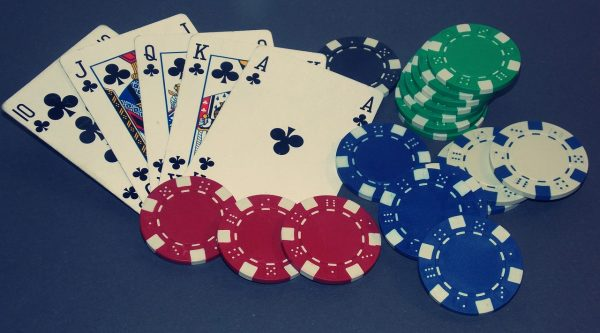Clubs Royale Flush playing cards with red, blue, black, white and green poker chips for the BHRC fundraiser
