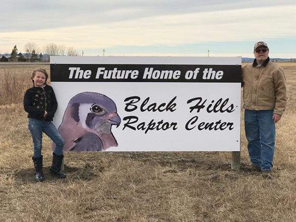 Photo of the future home of the Black Hills Raptor Center showing fence, green pasture and trees, for the Marco's Pizza Pizza Fund Raiser